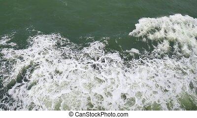 Foam left as ship go ahead, view ocean level from ferry boat