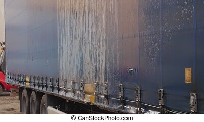 Foam on the trailer water drains outdoors washing