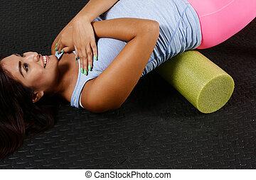 Foam Roller - Woman using a foam roller after a workout