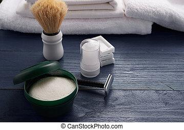 foam, shaving brush and shaving blade on the table