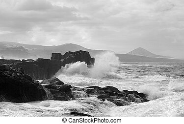 foaming waves by the shore at north of Gran Canaria,...