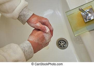 Foamy hands over a sink