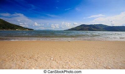 foamy wave surf of azure sea on island sandy beach