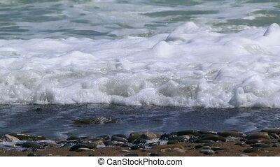 Foamy waves of the sea