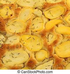 Focaccia with potatoes and rosemary on italian market