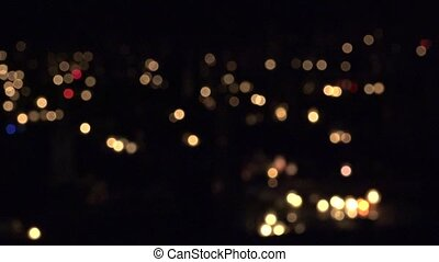 focus change many lighted candle on grave in cemetery dark. 4K