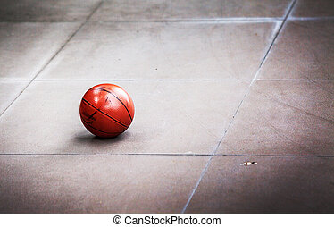 focus dirty basket ball on the cement floor
