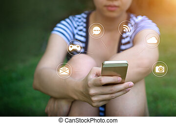 hand of Young woman touching smartphone