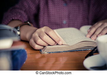 Focus hand open book for reading concept background