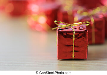Focus in red gift box place on wooden floor and background of unsharp.
