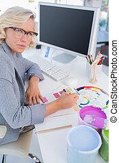 Focus interior designer looking at colour charts