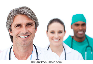 Focus on a mature doctor in front of his team
