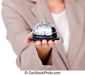 Focus on a service bell against a white background