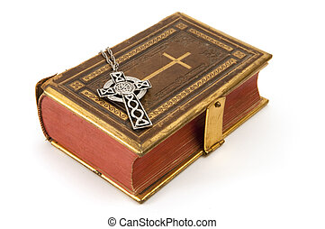 Focus on Celtic Cross - Cross on a antique Christian book...