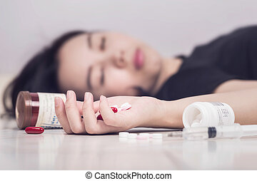 Focus on hand women after eaten pills overdose.