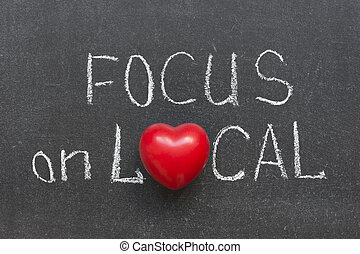 focus on local phrase handwritten on chalkboard with heart...