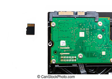 Micro SD (Secure Digital) card next to HDD Hard Disk Drive -...