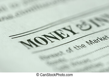 Shallow depth of field with money and paper texture in focus.