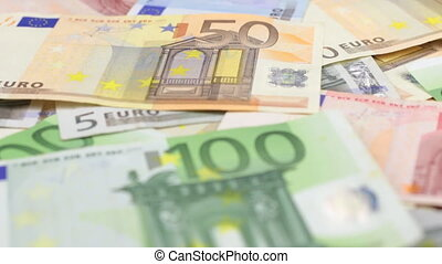 Focus on near and distant euro bills. Close-up.