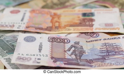 Focus on near and distant ruble bills. Close-up.