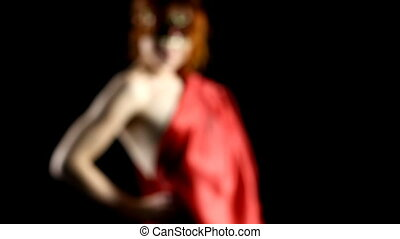 Focus on Red woman in mask in dark