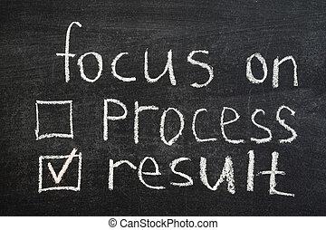 focus on result concept phrase handwritten on blackboard