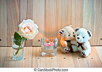Focus Pastel Rose, blurEmbrace Bears in love sit near Candlestick.