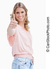 Focus shot of a woman with her thumb up