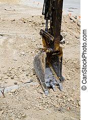 Focus shovel digging in dirt