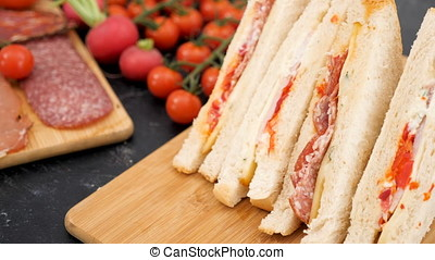 Focus tracking on club sandwich then on meat appetizers on...