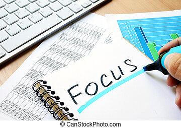 Focus written in a note.
