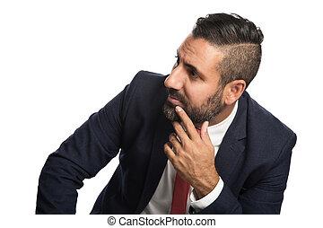 Focused businessman sitting down smiling