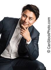 Focused businessman sitting down