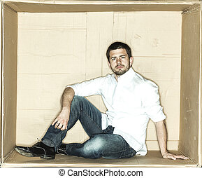 focused businessman sitting in a box