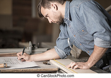 Focused carpenter at work