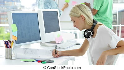 Focused creative designer sketching ideas in creative office