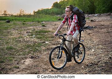 Focused cyclist riding on the beach