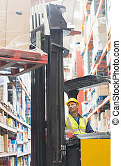 Focused driver operating forklift machine