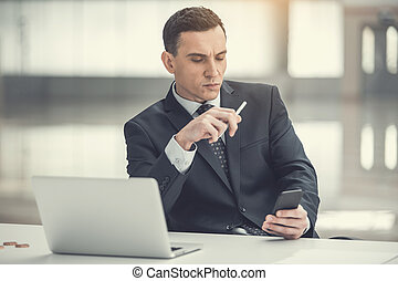 Focused employer typing in phone