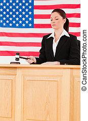 Focused judge knocking a gavel