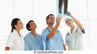 Focused medical team looking at xray