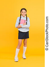 Focused on education. KId girl diligent student likes to study. Study in secondary school. Homeschooling and private lesson. Adorable child schoolgirl. Formal education. School education basics
