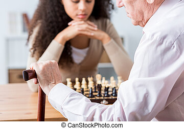 Focused people playing chess