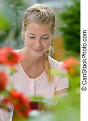 focused picture of woman reading in the garden