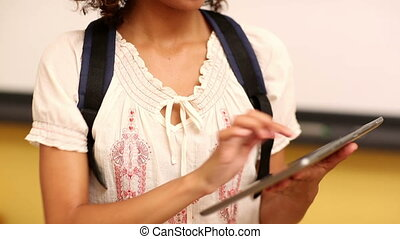 Focused student using a tablet in class