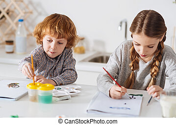 Focused talented children enjoying their creative morning