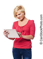 Focused woman using digital tablet
