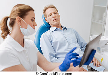 Focused worried man hearing doctors explanation - I will...