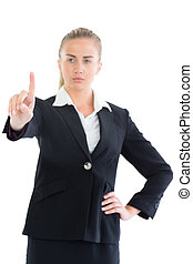 Focused young business woman pointing upwards