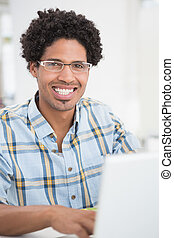 Focused young businessman smiling at camera